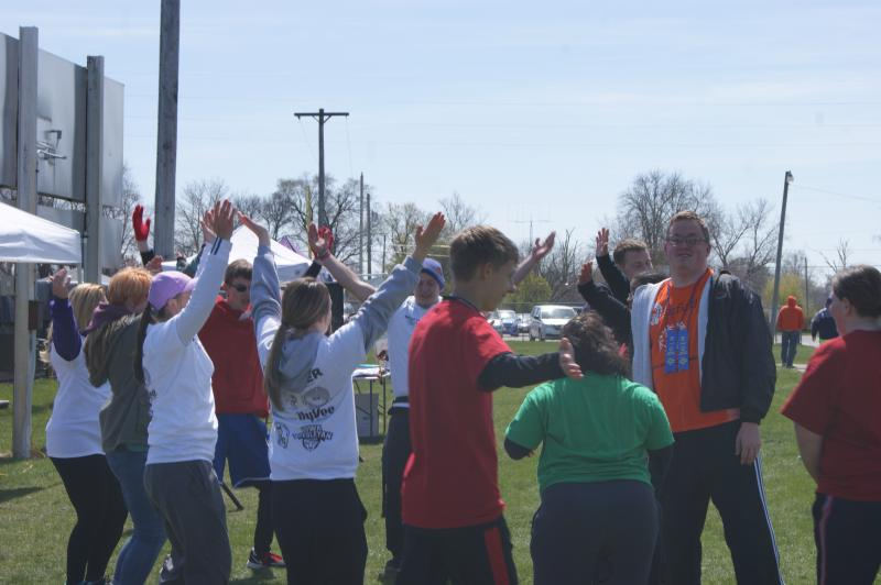 Special Olympic athletes and volunteer dance during a break in the day