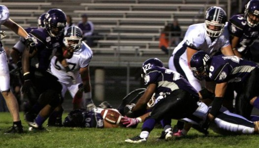 Elijah Albert (#22) recovers a fumble by St. Ambrose in the second quarter Saturday night. Photo courtesy Emily Situ