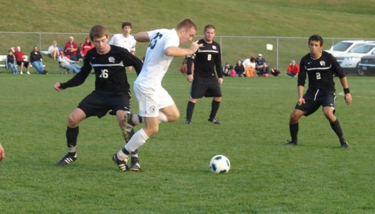 Connor Twomey (#16) battles for the ball as Chris Madigan (#8) and Dennis Palacios (#2) look on Saturday.