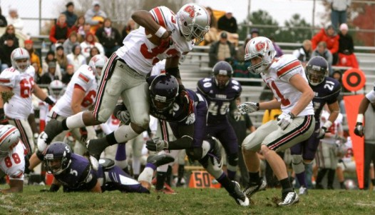 Duane Lee (#20) upends Grand View's Daryl Ford (#33) in Saturday's game. Photo courtesy Emily Situ.