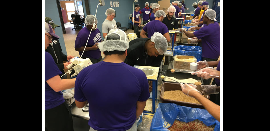 Photo for Tiger Football Teams up with University of Northwestern in Service
